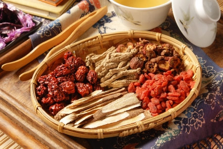 8551802 - different kind of chinese herbal medicine on wicker baskets